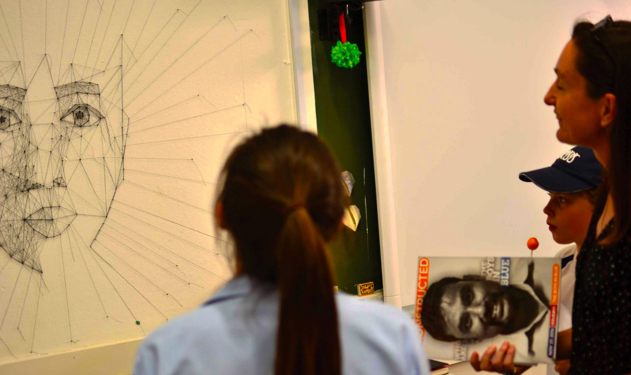 Dubai College student and colleagues viewing a scientific way of understanding how to draw the human face