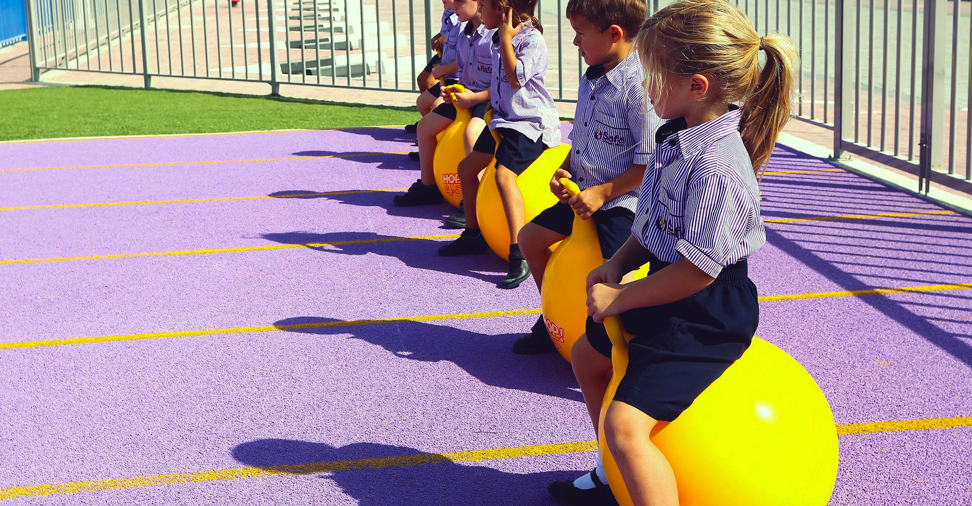 Young children have a race on bouncing toys at Safa Community School in Dubai