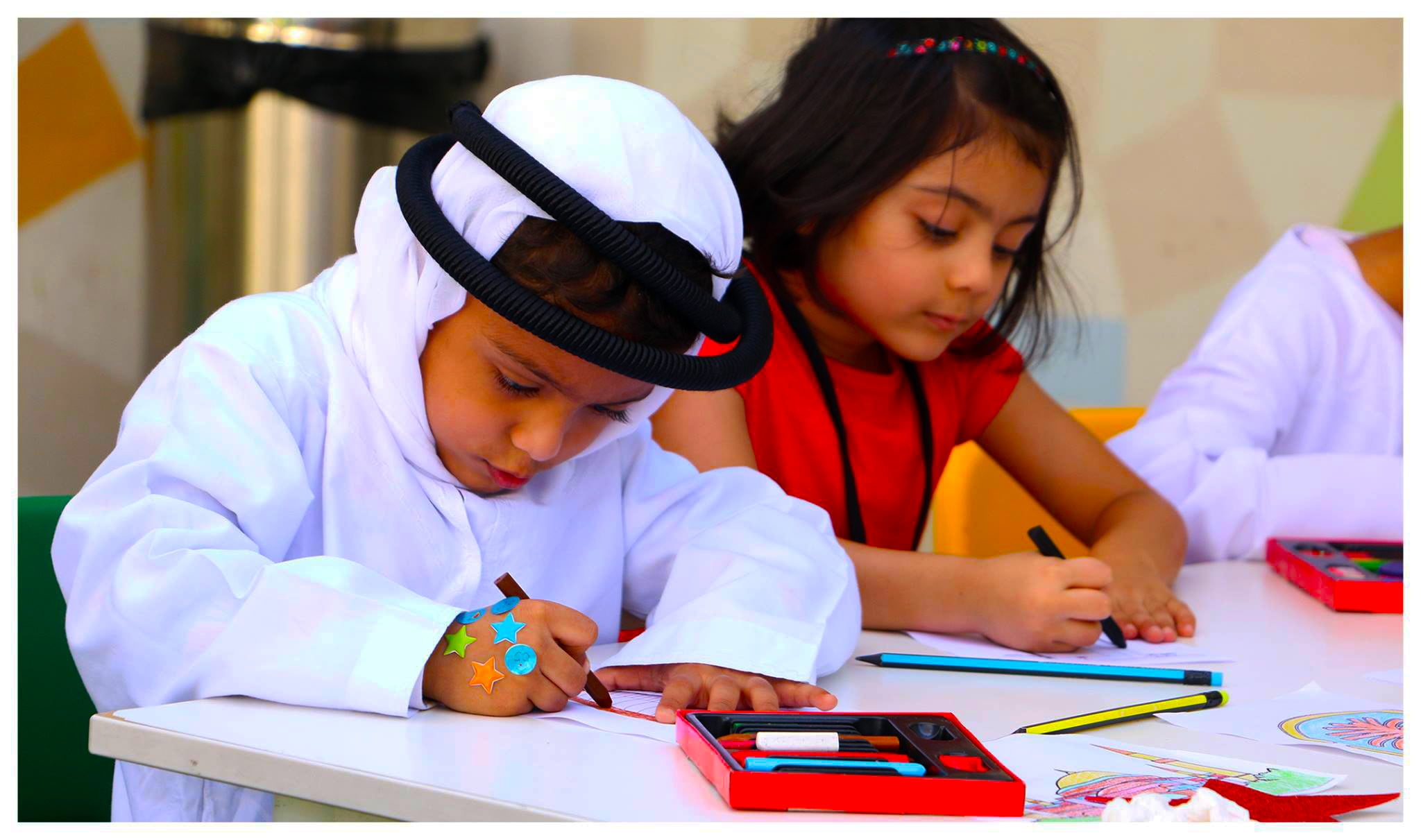 Photograph of children at the Ambassador Kindergarten and Nursery in Dubai engaged in art-based learning to develop creativity and fine motoring skills